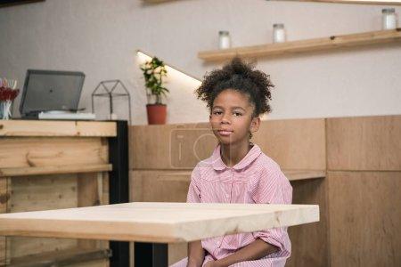 girl sitting alone in cafe