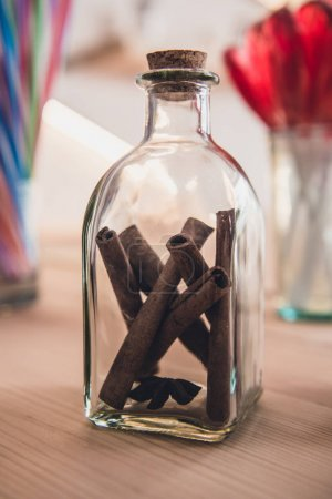 aromatic cinnamon sticks in bottle