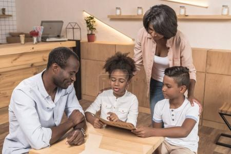 african-american family in cafe
