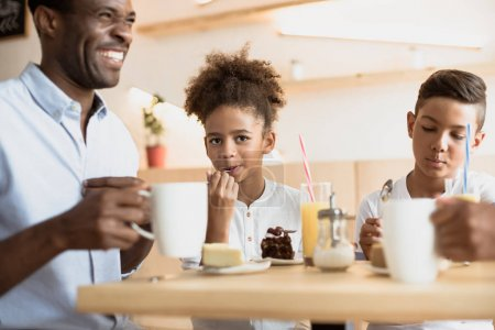 father and kids in cafe