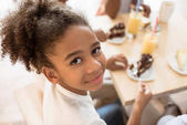 African-american girl in cafe
