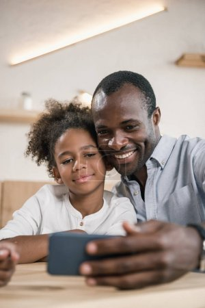 Photo for Adorable african-american father and daughter taking selfie - Royalty Free Image