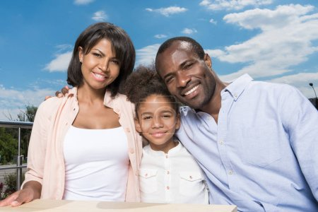 Photo for Beautiful african-american family bonding outdoors - Royalty Free Image
