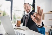 businessman showing okay sign
