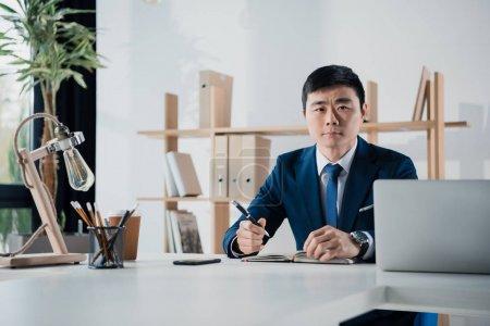 Serious asian businessman