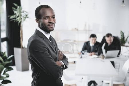 Photo for Handsome young african-american businessman with folded arms - Royalty Free Image