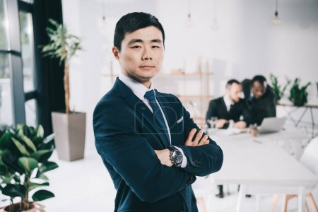 asian businessman with folded arms