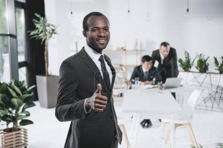 black businessman showing thumb up