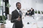 black businessman showing thumb up
