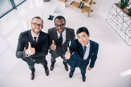 businessmen showing thumbs up