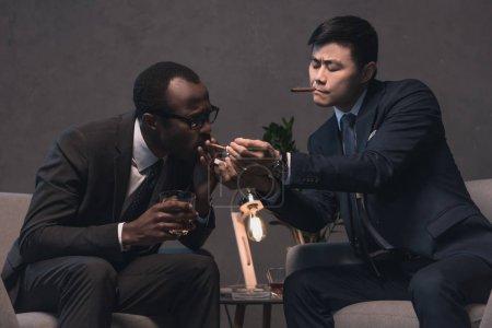 multiethic businessmen smoking cigars