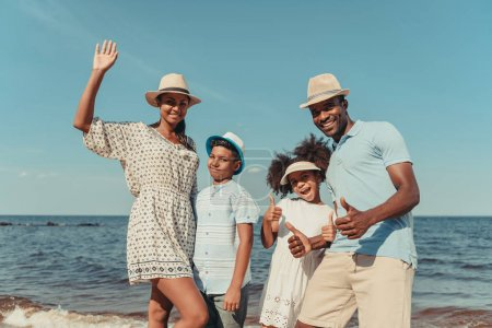 happy african american family on the beach