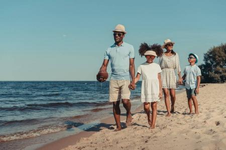 african american family walking on beach