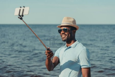 man taking selfie on beach