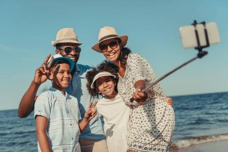 Family taking selfie on beach