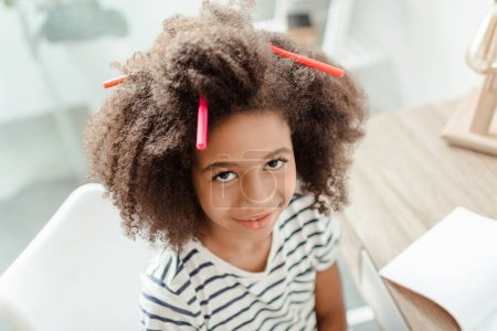 Little girl with markers in hair