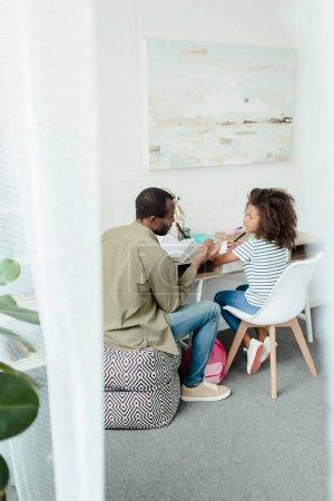 Dad helping daughter do homework