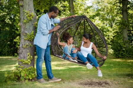 african american family on swing