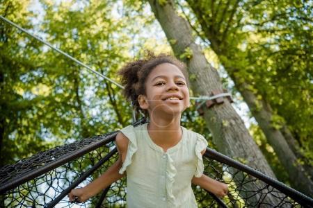 kid swinging on swing in park