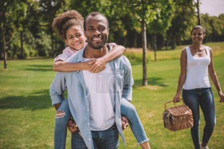 Happy afican american family in park