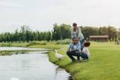 African american family near lake