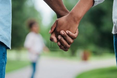 Photo for Cropped shot of african american couple holding hands - Royalty Free Image