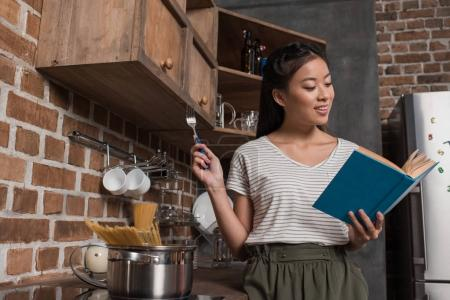student cooking and reading book
