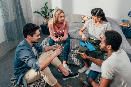 Photo for Group of young happy students studying at home in bedroom - Royalty Free Image