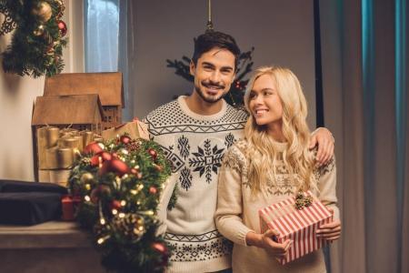 smiling couple on christmas eve