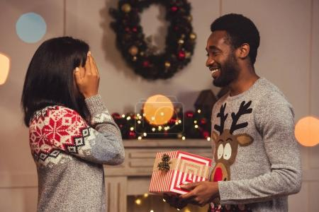 happy african american couple on christmas