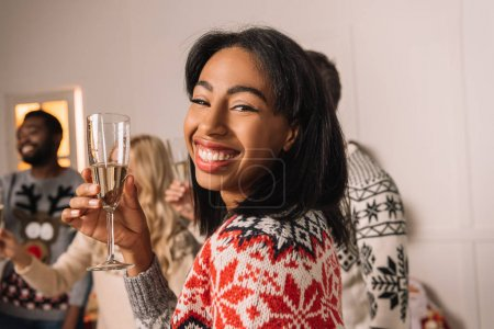 african american woman with glass of champagne