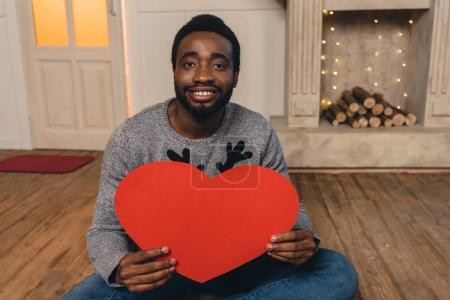 african american man with paper heart