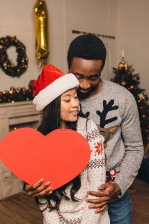 multicultural couple on christams eve