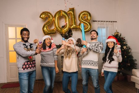 multicultural friends celebrating new year