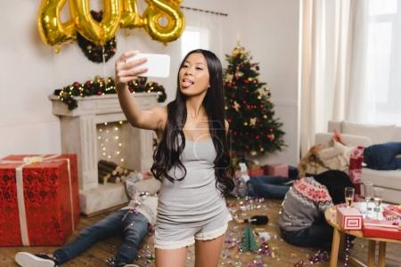 asian woman taking selfie