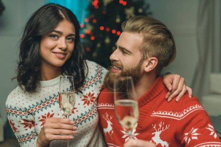couple with glasses of champagne on christmas