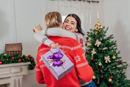 Woman embracing her boyfriend on christmas