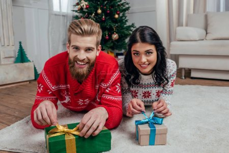 couple unpacking christmas gifts