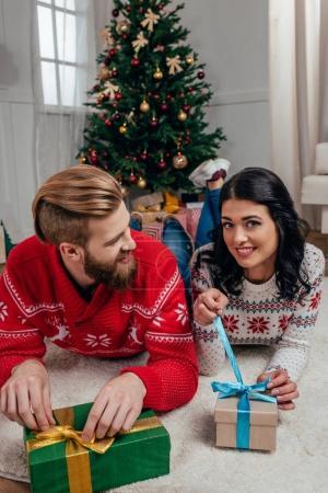 couple unpacking christmas gifts