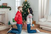 couple standing on knees with gifts