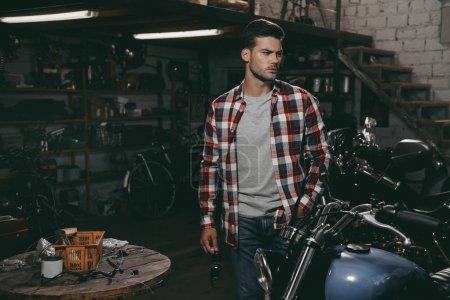 motorcyclist in repair shop