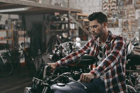 man with classic motorbike