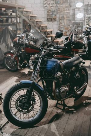 classic motorcycles in workshop