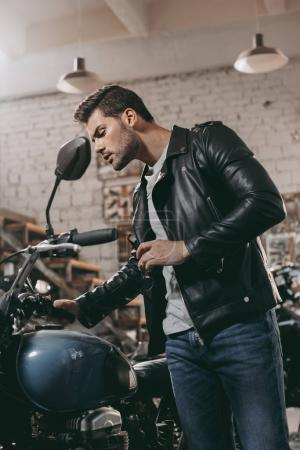 biker in leather jacket with motorcycle