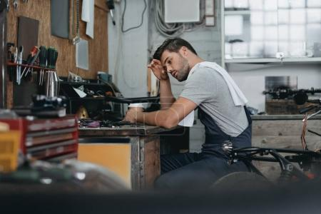 professional repairman in workshop