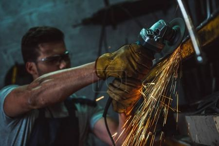 mechanic with circular saw