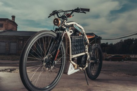 Photo for Vintage motorcycle standing outside at garage - Royalty Free Image