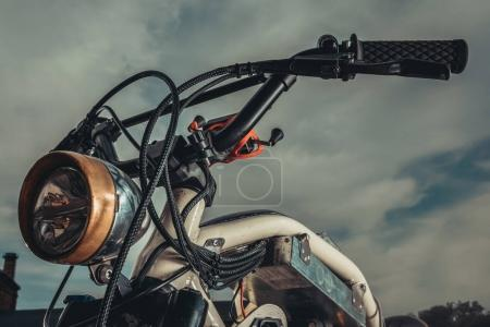 Photo for Close up of vintage motorcycle standing outside - Royalty Free Image