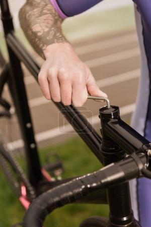 man repairing bicycle