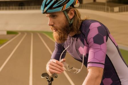 thoughtful cyclist in helmet